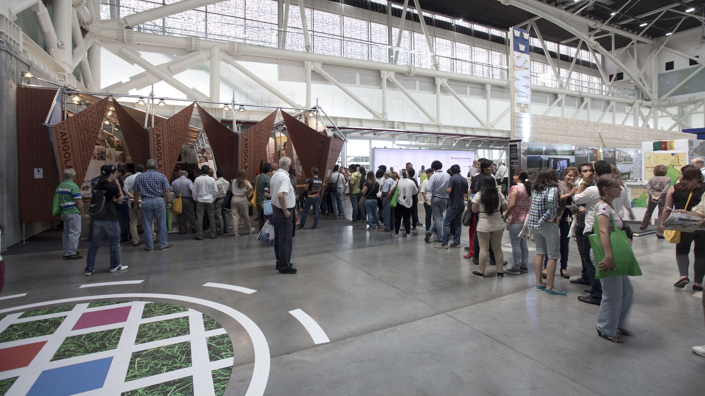 People queued to see the Angolan exhibition at the World Urban Forum in Medellin, Colombia
